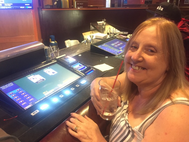Sue tries her hand at video blackjack at the bar